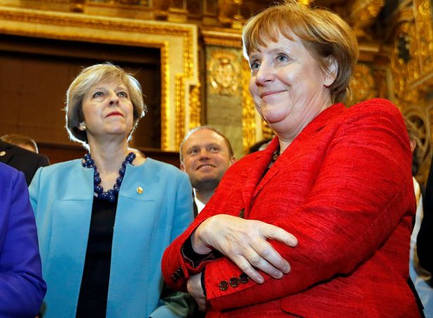 British-Prime-Minister-May-and-German-Chancellor-Merkel-visit-Saint-Johns-Co-Cathedral-during-a-bre